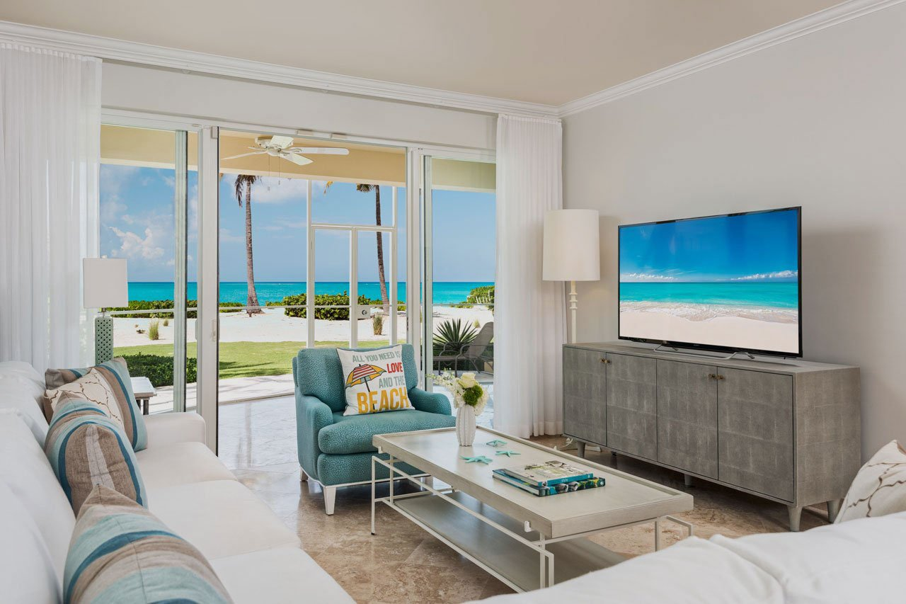 Caribbean-influenced living room at the tuscany resort on Grace Bay Beach